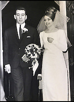 BNPS.co.uk (01202 558833)<br /> Pic: Gorringes/BNPS<br /> <br /> ****must use full byline****<br /> <br /> Reggie and Frances Kray on their wedding day.<br /> <br /> A diary kept by the tragic wife of Reggie Kray describing her hellish life with the gangster including having to share a bed with a gun and a flick-knife has emerged.<br /> <br /> Long-suffering Frances Kray wrote of the constant abuse and drunken temper bouts she endured at the hands of the East End villain.<br /> <br /> Describing how Reggie kept a cache of deadly weapons in their bedroom, she said: &quot;(He) came back night time. By the side of bed gun, sword, knife, chopper, flick-knife.<br /> <br /> &quot;He used to sleep with flick-knife under his pillow.&quot;<br /> <br /> The diary along with letters and photographs are being auctioned tomorrow (Weds) at Gorringes, East Sussex.