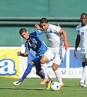 Honduras midfielder Emilio Izaguirre (7) shields the ball against El Salvador forward Nelson Bonilla (22) Honduras National Team defeated El Salvador 3-0 at RFK stadium, Saturday June 2, 2012.