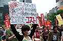 June 5, 2011- A women displays a sign at a Anti-Nuclear demo held in Shinbashi, Tokyo, Japan. Around 200 left-wing protesters marched in front of the the TEPCO office in Shinbashi chanting 'No Nukes, No more Hiroshima, No more Nagasaki and no more lies'. (Photo by B.Meyer-Kenny/2.0 Images)