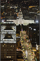 Looking down Congress Avenue in downtown Austin, Texas, I shot this picture of the State Capitol on a crisp night in December. My view came from the penthouse suite of a highrise in the middle of town and afforded quiet a view.