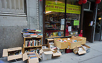 Second hand books for sale outside the progressive bookstore, Revolution Books, in the Chelsea neighborhood of New York, seen on Saturday, June 9, 2012. (© Richard B. Levine)