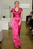 85 Broads member walks runway in an FW11 bright pink draping dress by Yuna Yang, during the 85 Broads Presents Yuna Yang trunk show at Art Gate Gallery on October 24th 2011.