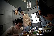 25 year old Chinese interpreter, Yuan Lei (centre) is seen talking to his room-mates while they eat breakfast at the dormitory of the Chinese Colony in the Adani Power plant in Mundra port industrial city of Gujarat, India. Indian power companies have handed out dozens of major contracts to Chinese firms since 2008. Adani Power Ltd have built elaborate Chinatowns to accommodate Chinese workers, complete with Chinese chefs, ping pong tables and Chinese television. Chinese companies now supply equipment for about 25% of the 80,000 megawatts in new capacity.