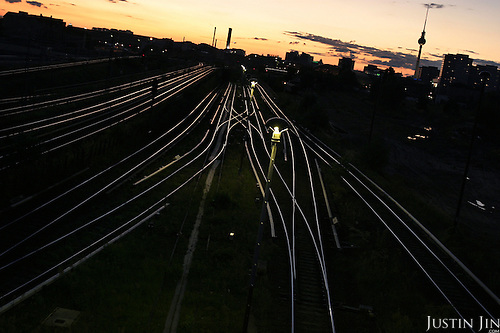 S-bahn and train tracks in east Berlin at dusk.  .