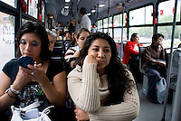"""A comuter puts on her make-up on Mexico City's public transportation's """"Women Only"""" bus Mexico D.F., Mexico.  Wednesday, April 30, 2008"""