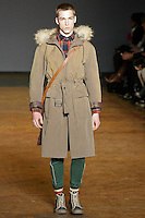 David walks runway in a canteen crispy cotton nylon parka, bright navy multi hunter plaid shirt, holly green tracksuit pant, gurgundy portfolio bag, and navy snakeskin hi-tops, from the Marc by Marc Jacobs Fall/Winter 2011 collection, during New York Fashion Week, Fall 2011.