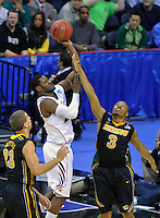Justin Safford of the Beartcats shoots over Tigers' Matt Pressey. Cincinnati defeated Missouri 78-63 during the NCAA tournament at the Verizon Center in Washington, D.C. on Thursday, March 17, 2011. Alan P. Santos/DC Sports Box