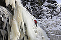 """22/01/13..Mark Procter (orange helmet) was the first climber to make the climb today...After many days below zero a giant waterfall has now frozen solid attracting climbers to tackle the huge 30 metre ascent up the freshly formed icicles and towers of ice. Known as Kinder Downfall the waterfall is the tallest in the Peak District. The river Kinder cascades over the top of the Kinder Scout plateau near the Pennine Way 2,087 ft above sea level mid-way between the villages of Hayfield and Edale in the High Peak of Derbyshire...Finding out when the waterfall is ready to climb is shrouded in secrecy. One of the six climbers who scaled the frozen spectacle today said: """"There's lots of misinformation on the internet, everyone wants to be the first to climb it as soon as it's in condition to climb""""...The climb up to the face of the waterfall took many hours today with climbers trudging through waist-deep snow-drifts before strapping on their crampons and using ice axes to scale the Downfall...All Rights Reserved - F Stop Press.  www.fstoppress.com. Tel: +44 (0)1335 300098."""