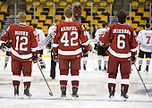 Colin Moore (Harvard - 12), Brendan Rempel (Harvard - 42), Ryan Grimshaw (Harvard - 6) - The Northeastern University Huskies defeated the Harvard University Crimson 4-0 in their Beanpot opener on Monday, February 7, 2011, at TD Garden in Boston, Massachusetts.