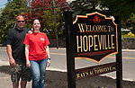 WATERBURY,  CT-051917JS05-Ray and Shannon Squatriglia, owners of Rays Automotive on Baldwin Street in Waterbury, recently installed a sign welcoming folks to the Hopeville section of town.  Jim Shannon Republican-American