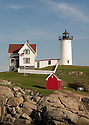 A popular lighthouse stands alone on its own island off the coast of York, Maine.