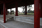 Two men pass through an empty walkway at the Citadel in the former imperial capital of Hue, Vietnam. Built in 1804, the Citadel was styled after the Forbidden City in Beijing, and was home to the ruling Nguyen dynasty until 1945, when the last emperor, Bao Dai, abdicated. Heavy fighting took place in the Citadel during the Tet Offensive of 1968, and many of its buildings were destroyed. Restoration efforts are ongoing. April 21, 2013.