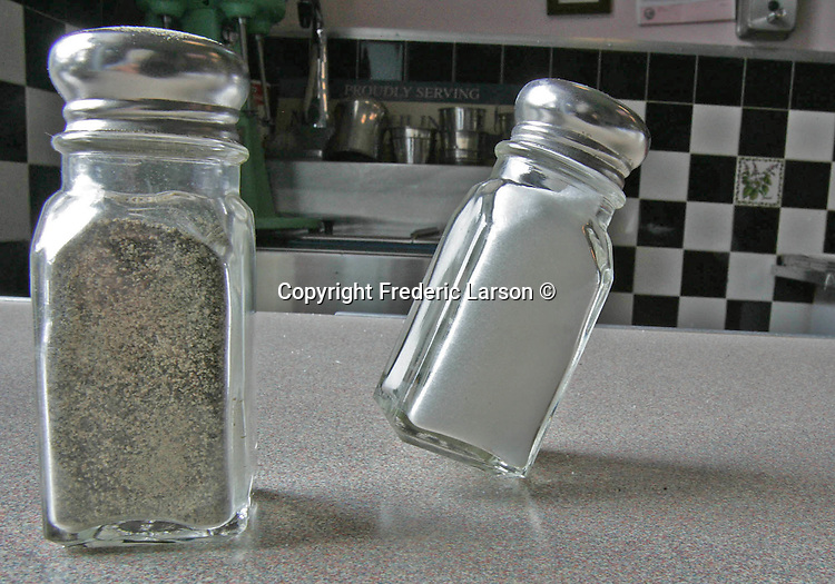 Salt and pepper at a diner in Albany California.