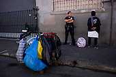Los Angeles, California..April 2, 2012....Police do a sweep and arrest homeless people on LA's skid row for minor infractions. Skid row is the home of up to 5,000 homeless people, many who are veterans and live on dozen or so streets that define the area. ....It is rarely policed as drugs such as marijuana, crack cocaine, methamphetamine and heroin are sold and used openly on the streets.
