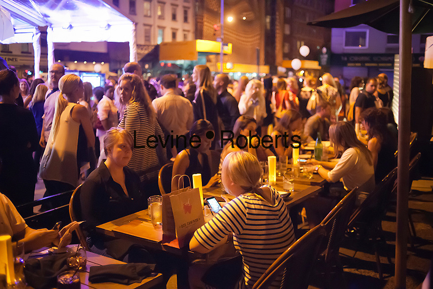 Diners eat al fresco in the trendy Meatpacking District in New York on Thursday, September 6, 2012 during the fourth annual Fashion's Night Out event.(© Richard B. Levine)
