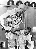 Washington, DC - April 19, 1998 -- Astronaut John H. Glenn, Jr. is assisted by Joe W. Schmitt as he suits up in practice for the perparation of the Mercury-Atlas 6 (MA-6) mission in the photo taken at Cape Canaveral, Florida on February 5, 1962..Credit: NASA / CNP