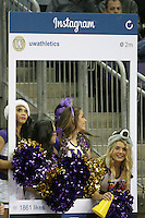 Dec 28, 2014:  Washington cheerleader Jordan French entertained fans during the game against Stony Brook.  Stony Brook defeated Washington 62-57 at Alaska Airlines Arena in Seattle, WA.