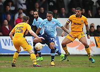 Blackpool's Neil Danns under pressure from Newport County's Mark O'Brien<br /> <br /> Photographer Kevin Barnes/CameraSport<br /> <br /> The EFL Sky Bet League Two - Saturday 18th March 2017 - Newport County v Blackpool - Rodney Parade - Newport<br /> <br /> World Copyright &copy; 2017 CameraSport. All rights reserved. 43 Linden Ave. Countesthorpe. Leicester. England. LE8 5PG - Tel: +44 (0) 116 277 4147 - admin@camerasport.com - www.camerasport.com