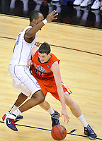 Bison's Mike Muscala drives the lane against Charles Okwandu of the Huskies. Connecticut defeated Bucknell 81-52 during the NCAA tournament at the Verizon Center in Washington, D.C. on Thursday, March 17, 2011. Alan P. Santos/DC Sports Box