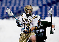 Patrick Moran (13) of Navy tries to work past Kevin Moriarty (38) of Loyola at the Navy-Marine Corp Memorial Stadium in Annapolis, Maryland.   Loyola defeated Navy, 8-7, in overtime.