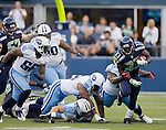 Seattle Seahawks' running back Leon Washington breaks an attempted tackles en-route for an eight-yard gain against the Tennessee Titans at CenturyLink Field in Seattle, Washington on August 11,  2012. ©2012. Jim Bryant Photo. All Rights Reserved...