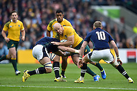 Stephen Moore of Australia takes on the Scotland defence. Rugby World Cup Quarter Final between Australia and Scotland on October 18, 2015 at Twickenham Stadium in London, England. Photo by: Patrick Khachfe / Onside Images