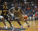 "Ole Miss guard Nick Williams (20) dribbles against Southern Mississippi forward Josimar Ayarza (3) at C.M. ""Tad"" Smith Coliseum in Oxford, Miss. on Saturday, December 4, 2010."