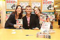 NO REPRO FEE. 8/10/2011.Eason, Ireland's leading retailer of books, stationery, magazines and lots more, hosted a book signing by comedian Des Bishop. Pictured at Eason O'Connell Street, Dublin are fans Lorraine Kelly from Sligo and Tanya Maguire from Mullingar and Des Bishop who signed copies of his new book My Dad was nearly James Bond. Follow Eason on Twitter - @easons For further information, please contact: Aoife McDonald WHPR 087 4100777 Picture James Horan/Collins Photos