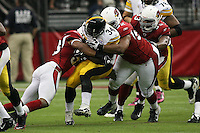 10/23/11 Glendale, AZ: Pittsburgh Steelers running back Rashard Mendenhall #34 and Arizona Cardinals outside linebacker Clark Haggans #53, nose tackle Dan Williams #92 during an NFL game played at University of Phoenix Stadium between the Arizona Cardinals and the Pittsburgh Steelers. The Steelers defeated the Cardinals 32-20.