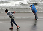 Two women try to walk along the beach through high winds from Hurricane Isabel September 18, 2003 in North Wildwood, New Jersey. Hurricane Isabel brought high winds and heavy surf to the New Jersey coast. (Photo by William Thomas Cain/photodx.com)