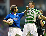 Neil McCann lifts Joos Valgaeren off the deck by his shirt during the Rangers v Celtic match at Ibrox in Feb 2001.