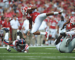 Arkansas running back Knile Davis (7) is upended by Ole Miss cornerback Charles Sawyer (3) at Reynolds Razorback Stadium in Fayetteville, Ark. on Saturday, October 23, 2010.