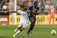 Conor Doyle (30) of D. C. United and Amobi Okugo (14) of the Philadelphia Union. The Philadelphia Union defeated D. C. United 2-0 during a Major League Soccer (MLS) match at PPL Park in Chester, PA, on August 10, 2013.