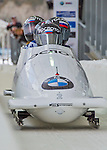 9 January 2016: Russian pilot Alexander Kasjanov leads his 4-man team as they cross the finish line after their second run of the day at the BMW IBSF World Cup Bobsled Championships at the Olympic Sports Track in Lake Placid, New York, USA. Kasjanov's team won the silver with a 2-run combined time of 1:49.98. Mandatory Credit: Ed Wolfstein Photo *** RAW (NEF) Image File Available ***