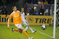 Houston Dynamo goalie (1) Tally Hall can't stop Los Angeles Galaxy's London Donovan as he kicks in the winning goal against Houston Dynamo to make the score  1-0 in the MLS Cup at the Home Depot Center. Los Angeles Galaxy 1-0 over the Dynamo USA, Sunday, Nov. 20. 20011, in Carson, California. Photo by Matt A. Brown/isiphotos.com