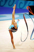 Dominika Cervenkova of Czech Republic waves ribbon from balance during qualifications round at 2004 Athens Olympic Games on August 27, 2006 at Athens, Greece. (Photo by Tom Theobald)