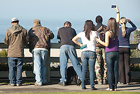 Spectators look from Palisades Park for the sign of a possible Tsunami  advisory on Friday, March11, 2011.