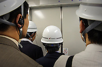Journalalists in a lift touring the J-Power Isogo plant, Yokohama, Japan, September 29 2009. J-Power's coal burning power station near Tokyo is one of the most advanced and efficient in the world.