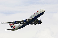 British Airways Jumbo Jet flying away from Heathrow, London, United Kingdom