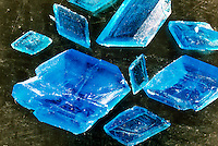 CUPRIC SULFATE PENTAHYDRATE CRYSTALS<br /> CuSO4*5H2O (Copper II Sulfate)<br /> Evaporation of a water solution of CuSO4 yields triclinic blue crystals of CuSO4.5H2O, which is composed of hydrated copper ions, Cu(H2O)4 2+ and hydrated sulfate ions, SO4(H2O) 2-. Compound of small, highly positively charged ions commonly form hydrates.