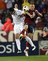 Jay DeMerit(15) of the USA MNT clashes with Marcelo Alejandro Estigambia(18) of Paraguay during an international friendly match at LP Field, in Nashville, TN. on March 29, 2011. Paraguay won 1-0.