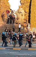 Roma  15 Ottobre 2011.Manifestazione contro la crisi e l'austerità.Scontri tra manifestanti e forze dell'ordine.Le forze dell'ordine fermano un manifestante.