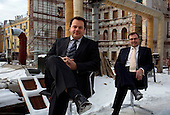 Kestutis Sasnauskas (left), a partner at investment house East Capital, and Jurki Talvitie, head of the firm's Moscow Office, sit for a portrait outside their office in central Moscow.