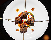 Bodega lamb; grilled marinated lamb skewers served over Harissa Romesco sauce, Babylon, 309 N Dawson St., Raleigh, N.C., Sat., July 30, 2011.