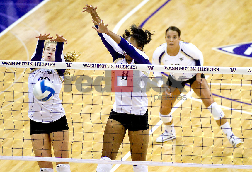Summer Ross, Lauren Barfield, Evan Sanders. The University of Washington women's volleyball team plays USC Trojans at Alaska Airlines Arena at the University of Washington in Seattle on Friday September 16, 2011. (Photography By Scott Eklund/Red Box Pictures)