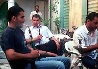 Libyan Arab Jamahiriya   .Tripoli       June 2002. The Medina The two men smoke narghile .Libia Tripoli  Giugno 2002.La Medina.Due uomini fumano il narghile.