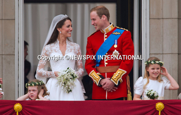 "PRINCE WILLIAM AND CATHERINE MIDDLETON.a lot can read into a public kiss and body language..Prince William and Catherine Middleton on the Buckingham Palace Balcony..THE ROYAL WEDDING.Prince William and Catherine Middleton delight the crowds with a kiss..The Newly married coupleThe Duke and Duchess of Cambridge take in the splendor of the crowds from the balcony of Buckingham Palace..Prince William and Catherine Middleton marry at Westminster Abbey..The Duke and Duchess of Cambridge London_29/04/2011.Mandatory Photo Credit: ©Dias/Newspix International..**ALL FEES PAYABLE TO: ""NEWSPIX INTERNATIONAL""**..PHOTO CREDIT MANDATORY!!: NEWSPIX INTERNATIONAL(Failure to credit will incur a surcharge of 100% of reproduction fees)..IMMEDIATE CONFIRMATION OF USAGE REQUIRED:.Newspix International, 31 Chinnery Hill, Bishop's Stortford, ENGLAND CM23 3PS.Tel:+441279 324672  ; Fax: +441279656877.Mobile:  0777568 1153.e-mail: info@newspixinternational.co.uk"
