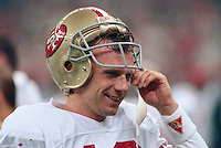 NEW ORLEANS, LA - Quarterback Joe Montana of the San Francisco 49ers smiles on the sidelines during Super Bowl XXIV against the Denver Broncos at the Superdome in New Orleans, Louisiana in January of 1990. Photo by Brad Mangin.