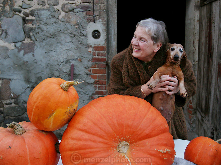 In Kazimierz, Poland on All Saints Day. Wiezowski/Ledochowicz family visits relatives' graves and later has dinner together at great grandma's farmhouse. This is grandma Honorata, with her dog.