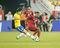 Brazil midfielder Hernanes (8) intercepts the ball in front of Portugal forward Nani (17) In an International friendly match Brazil defeated Portugal, 3-1, at Gillette Stadium on Sep 10, 2013.